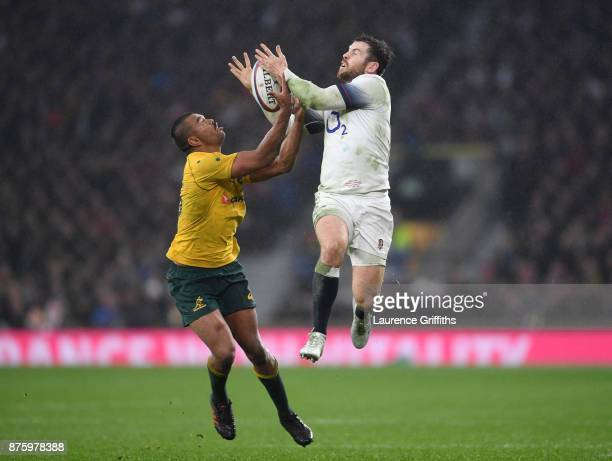 Kurtley Beale of Australia takes the high ball from Elliot Daly of England during the Old Mutual Wealth Series match between Engalnd and Australia at...