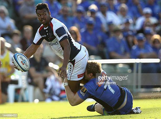 Kurtley Beale of the Rebels is tackled by David Pocock of the Force during the round 13 Super Rugby match between the Western Force and the Melbourne...