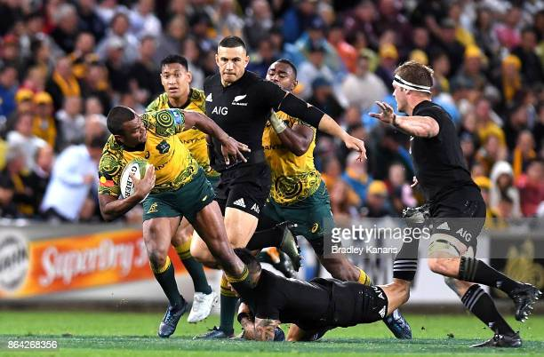 Kurtley Beale of the Wallabies breaks away from the defence during the Bledisloe Cup match between the Australian Wallabies and the New Zealand All...