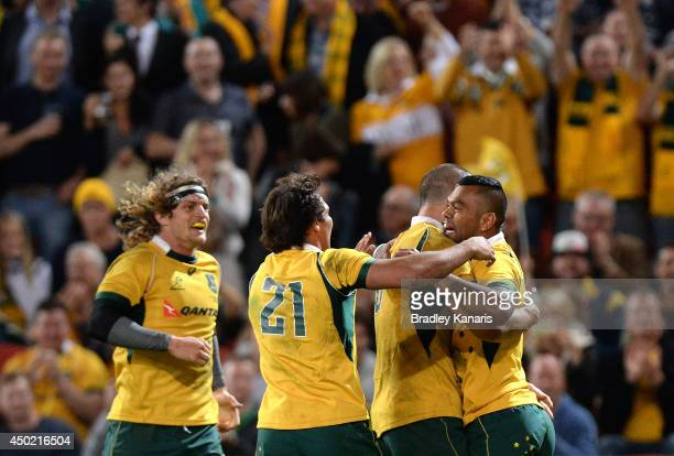 Kurtley Beale of the Wallabies celebrates with team mates after scoring a try during the First International Test Match between the Australian...