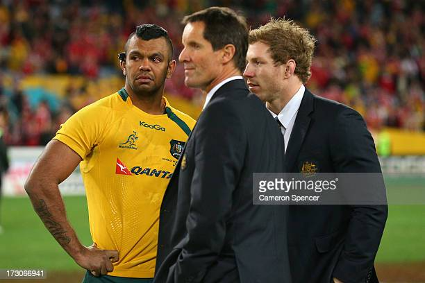 Kurtley Beale of the Wallabies, coach Robbie Deans and injured Wallaby David Pocock look dejected after losing the International Test match between...