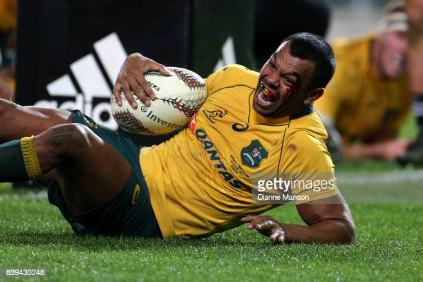 Kurtley Beale of the Wallabies dives over to score a try during The Rugby Championship Bledisloe Cup match between the New Zealand All Blacks and the...
