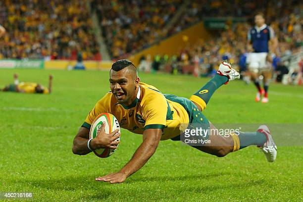 Kurtley Beale of the Wallabies dives to score a try during the First International Test Match between the Australian Wallabies and France at Suncorp...
