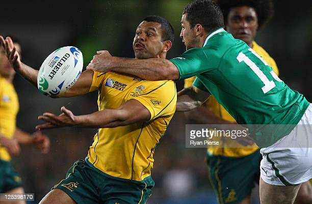 Kurtley Beale of the Wallabies is high tackled by Rob Kearney of Ireland during the IRB 2011 Rugby World Cup Pool C match between Australia and...