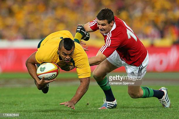 Kurtley Beale of the Wallabies is tackled by Johnny Sexton of the Lions during the International Test match between the Australian Wallabies and...