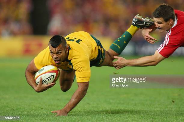 Kurtley Beale of the Wallabies is tackled by Jonathon Sexton of the British Irish Lions during the International Test match between the Australian...