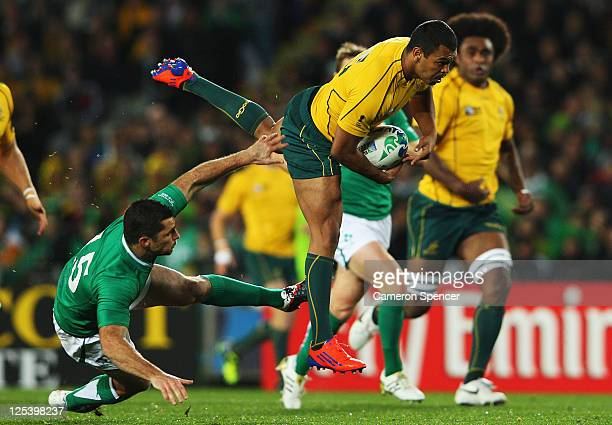 Kurtley Beale of the Wallabies is tackled by Rob Kearney of Ireland during the IRB 2011 Rugby World Cup Pool C match between Australia and Ireland at...