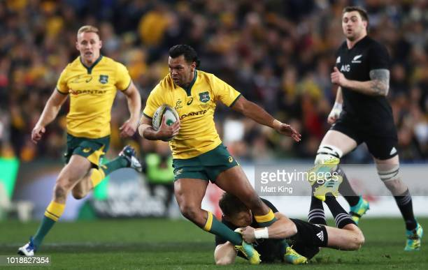 Kurtley Beale of the Wallabies is tackled during The Rugby Championship Bledisloe Cup match between the Australian Wallabies and the New Zealand All...