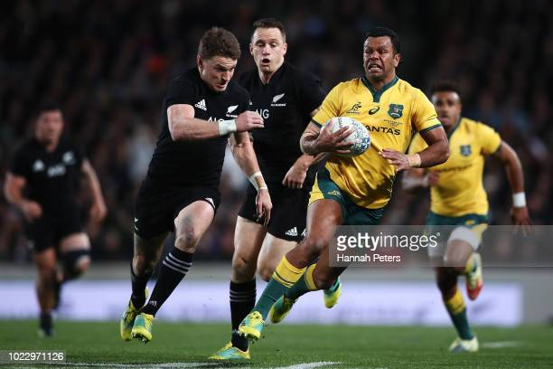 Kurtley Beale of the Wallabies makes a break during The Rugby Championship game between the New Zealand All Blacks and the Australia Wallabies at...