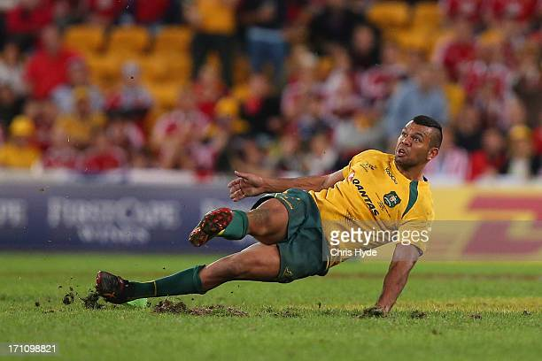 Kurtley Beale of the Wallabies slips over while kicking for goal during the First Test match between the Australian Wallabies and the British Irish...