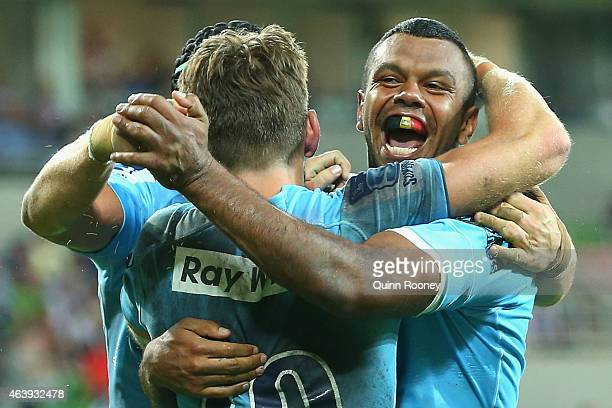 Kurtley Beale of the Waratahs is congratulated by team mates after scoring a try during the round two Super Rugby match between the Rebels and the...