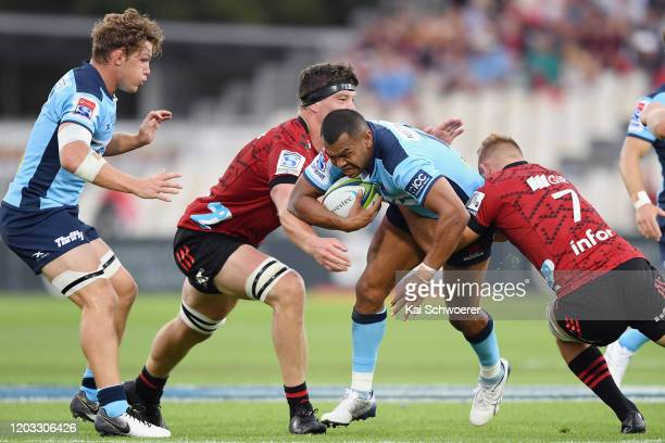 Kurtley Beale of the Waratahs is tackled by Scott Barrett of the Crusaders and Tom Christie of the Crusaders during the Round 1 Super Rugby match...