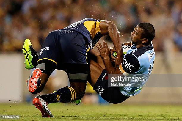 Kurtley Beale of the Waratahs is tackled by Tevita Kuridrani of the Brumbies during the round two NRL match between the Brumbies and the Waratahs at...