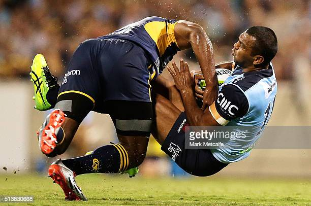 CANBERRA AUSTRALIA MARCH Kurtley Beale of the Waratahs is tackled by Tevita Kuridrani of the Brumbies during the round two NRL match between the...