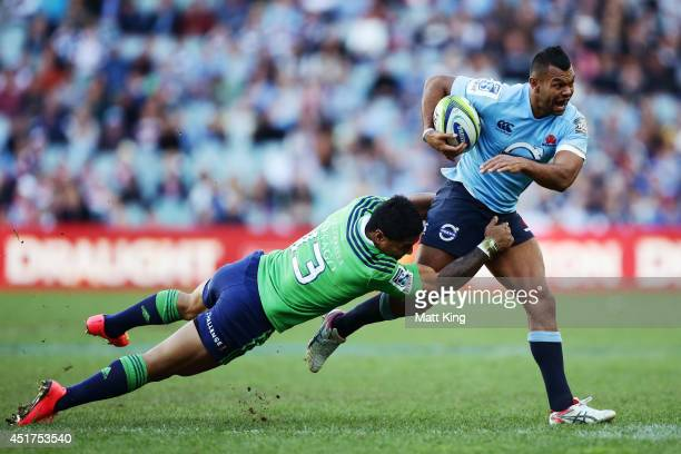 Kurtley Beale of the Waratahs is tackled during the round 18 Super Rugby match between the Waratahs and the Highlanders at Allianz Stadium on July 6...