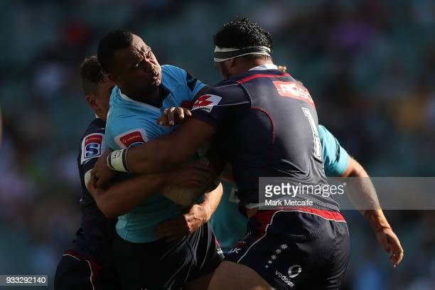 Kurtley Beale of the Waratahs is tackled during the round five Super Rugby match between the Waratahs and the Rebels at Allianz Stadium on March 18...