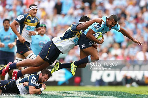 Kurtley Beale of the Waratahs is tackled during the round six Super Rugby match between the Waratahs and the Brumbies at Allianz Stadium on March 22...