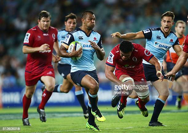 Kurtley Beale of the Waratahs makes a break during the round one Super Rugby match between the Waratahs and the Reds at Allianz Stadium on February...