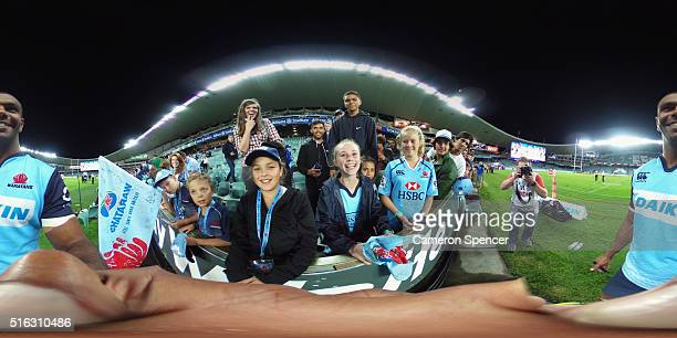 Kurtley Beale of the Waratahs poses with fans following the Super Rugby match between the New South Wales Waratahs and the Highlanders at Allianz...