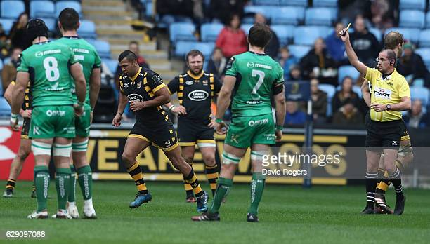 Kurtley Beale of Wasps is shown the yellow card by referee Alexandre Ruiz during the European Champions Cup match between Wasps and Connacht at the...