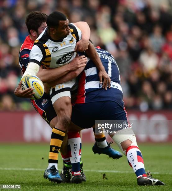 Kurtley Beale of Wasps is tackled by Ryan Bevington of Bristol Rugby and Marc Jones of Bristol Rugby during the Aviva Premiership match between...