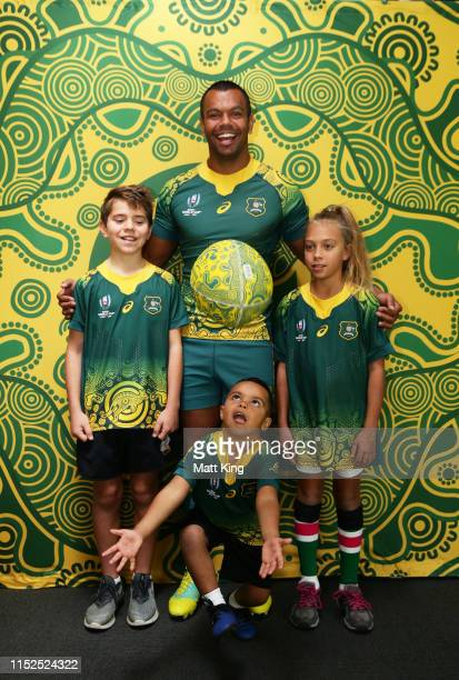 Kurtley Beale poses with children in the Wallabies Indigenous jersey to be worn at the 2019 Rugby World Cup during a Wallabies media opportunity at...