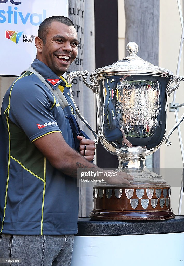 Kurtley Beale poses with the Bledisloe Cup during the Australian Wallabies Bledisloe Cup launch at the Museum of Sydney on August 9, 2013 in Sydney, Australia.