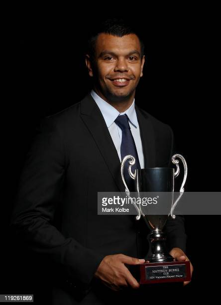 Kurtley Beale poses with the Matthew Burke Cup awarded for the Waratahs player's player of the 2011 Super Rugby season during the Waratahs 2011 Gala...