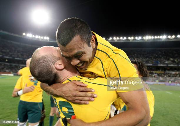 Kurtley Beale the Wallaby fullback celebrates with team mate Richard Brown after scoring the match winning penalty during the 2010 TriNations match...
