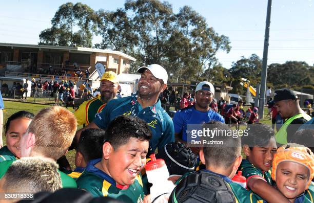 Kurtley Beale with some of the junior teams during an Australian Wallabies fan day on August 13 2017 in Penrith Australia