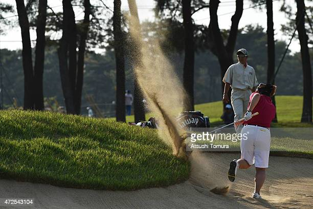 Kurumi Dohi of Japan hits her shot out from a bunker on the 18th hole during the second round of the World Ladies Championship Salonpas Cup at the...