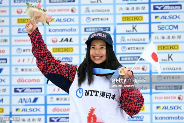 Kurumi Imai of Japan poses on the podium during the medal ceremony for the Snowboarding ladies halfpipe on the day eight of the 2017 Sapporo Asian...