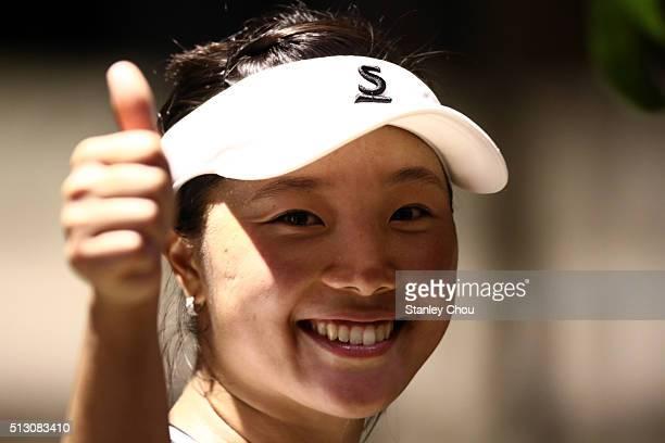 Kurumi Nara of Japan celebrates after she defeated Daniela Hantuchova of Slovakia during round one of the 2016 BMW Malaysian Open at Kuala Lumpur...