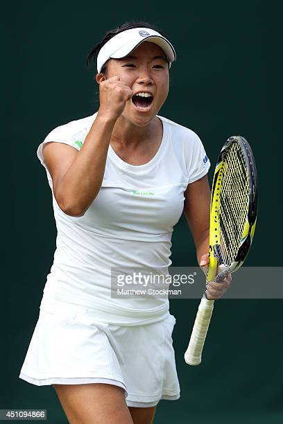 Kurumi Nara of Japan celebrates during her Ladies' Singles first round match against AnnaLena Friedsam of Germany on day one of the Wimbledon Lawn...