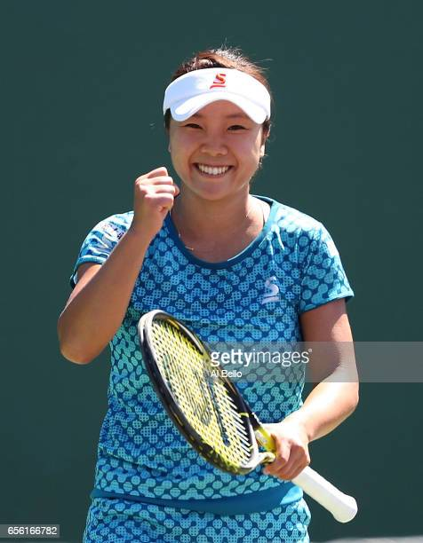 Kurumi Nara of Japan celebrates match point against Francesca Schiavone of Italy after defeating her during Day 2 of the Miami Open at Crandon Park...