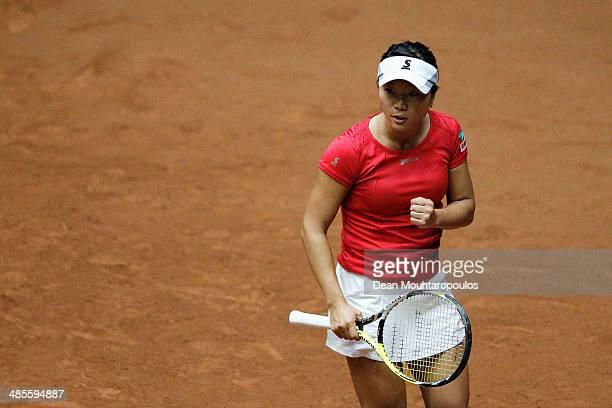 'SHERTOGENBOSCH NETHERLANDS APRIL 19 Kurumi Nara of Japan celebrates winning a point in her match against Arantxa Rus of Netherlands during the Fed...