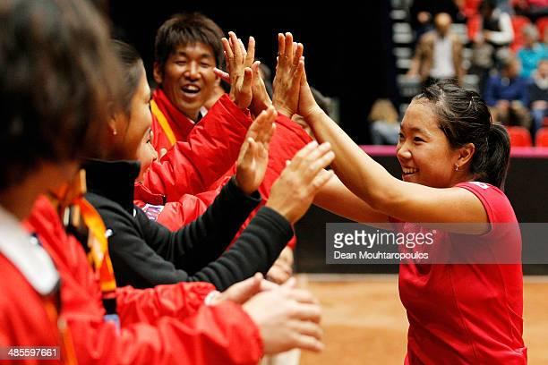 'SHERTOGENBOSCH NETHERLANDS APRIL 19 Kurumi Nara of Japan celebrates winning her match against Arantxa Rus of Netherlands with her team during the...