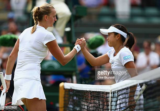 Kurumi Nara of Japan congratulates Petra Kvitova of Czech Republic at the net after defeat in her Ladies Singles Second Round match during day four...