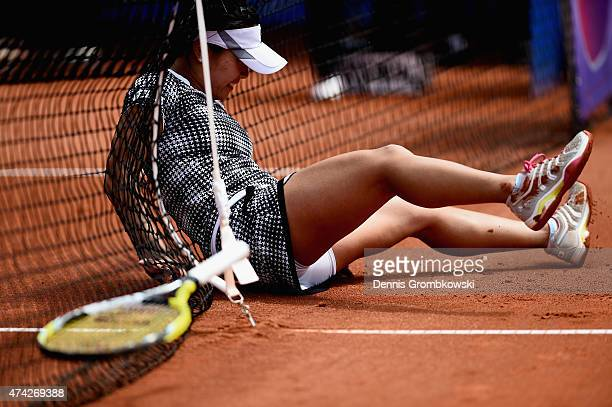 Kurumi Nara of Japan falls over during her match against Roberta Vinci of Italy during Day six of the Nuernberger Versicherungscup 2015 on May 21...