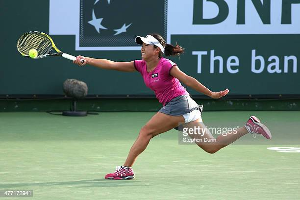Kurumi Nara of Japan hits a return to Simona Halep of Romania during the BNP Paribas Open at Indian Wells Tennis Garden on March 7 2014 in Indian...