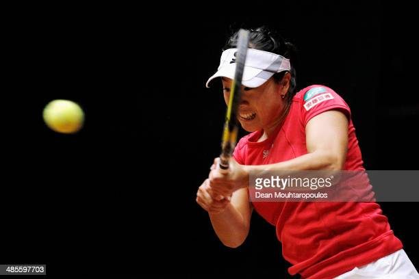 'SHERTOGENBOSCH NETHERLANDS APRIL 19 Kurumi Nara of Japan in action against Arantxa Rus of Netherlands during the Fed Cup World Group II Playoff...