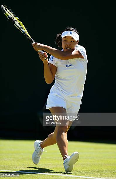 Kurumi Nara of Japan in action in her Ladies Singles first round match against Magda Linette of Poland during day two of the Wimbledon Lawn Tennis...