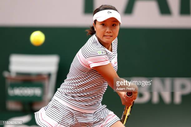 Kurumi Nara of Japan plays a backhand during her ladies singles second round match against Serena Williams of The United States during Day five of...