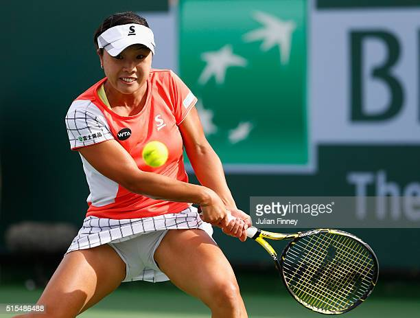 Kurumi Nara of Japan plays a backhand in her match against Barbora Strycova of Czech Republic during day seven of the BNP Paribas Open at Indian...