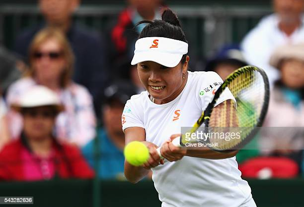 Kurumi Nara of Japan plays a backhand shot during the Ladies first round match against Madison Brengle of The United States on day one of the...