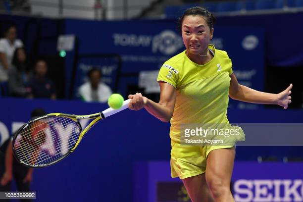 Kurumi Nara of Japan plays a forehand against Victoria Azarenka of Belarus during their Women's singles first round match on day two of the Toray Pan...