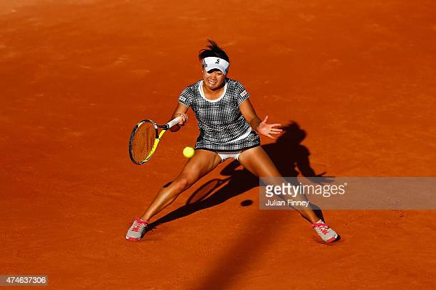 Kurumi Nara of Japan plays a forehand during her Women's Singles match against Oceane Dodin of France on day one of the 2015 French Open at Roland...