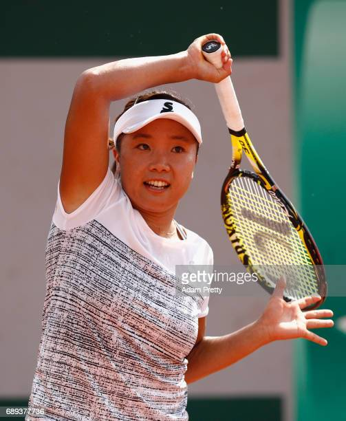 Kurumi Nara of Japan plays a forehand during the ladies singles first round match against Amanda Anisimova of The United States on day one of the...
