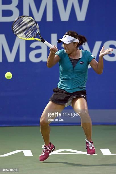 Kurumi Nara of Japan plays a shot to Magda Linette of Poland during day three of the BMW Malaysian Open at the Royal Selangor Golf Club Tennis Centre...