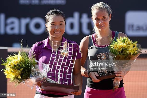 Kurumi Nara of Japan poses with Klara Zakopalova of the Czech Republic after winning the 2014 Rio Open women's singles final during the ATP Rio Open...